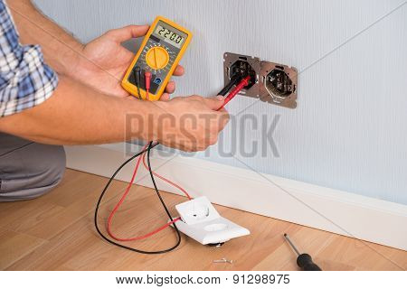 Person Hand Checking Socket Voltage