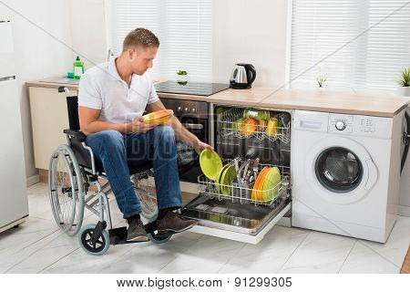 Disabled Man Working In Kitchen