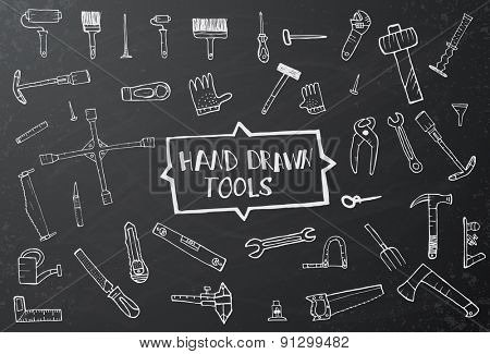 Hand drawn tool icons set on black chalk board. Vector illustration