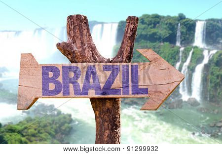 Brazil wooden sign with Iguazu Falls on background