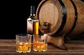 picture of whiskey  - Whiskey and oak barrel on a black background - JPG