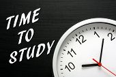 picture of time study  - The phrase Time To Study in white text on a blackboard next to a modern clock - JPG