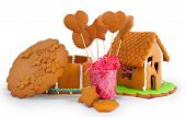 stock photo of gingerbread house  - Gingerbread house and gingerbread isolated on white background - JPG
