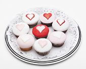 stock photo of icing  - cupcakes with heart icing on white background isolated on a white background - JPG