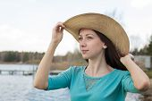picture of windy  - Freckled happy girl in hat dreaming on a windy day - JPG