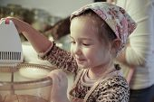 pic of cake-mixer  - Happy little girl mixing dough for a birthday cake being independent helping mum in the kitchen - JPG