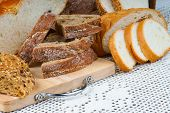 stock photo of fresh slice bread  - Assortment of sliced fresh bread on a cutting board - JPG