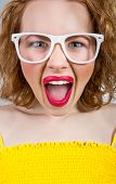 stock photo of scream  - Young funny or angry woman screaming or yell close up facial - JPG
