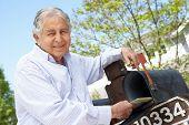 image of mailbox  - Senior Hispanic Man Checking Mailbox - JPG