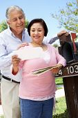 foto of mailbox  - Senior Hispanic Couple Checking Mailbox - JPG