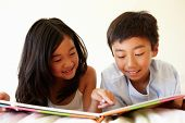 pic of pre-teen boy  - Young Asian girl and boy reading book - JPG