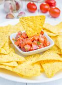 picture of nachos  - Fresh homemade salsa with nachos on the white plate - JPG
