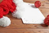 picture of letters to santa claus  - Letter to the Santa Claus composition of the copyspace blank sheet of paper next to multiple Christmas decorations over the wooden surface - JPG
