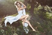 stock photo of natural blonde  - Cute blonde sexy woman in nature scenery - JPG