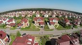 picture of car ride  - Aerial view car rides by road in cottage town at sunny summer day - JPG
