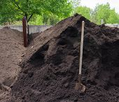 pic of yard sale  - pile of rich fertile compost made locally from organic wastes available for sale to apply on gardens - JPG