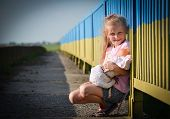 image of old bridge  - Little girl with a doll on the old bridge  - JPG