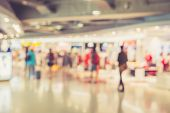 stock photo of mall  - Blurred image of people in shopping mall with bokeh vintage color - JPG