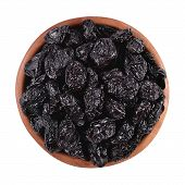 picture of prunes  - Prunes in a wooden bowl on a white background - JPG