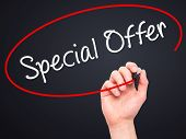 picture of enticing  - Man Hand writing Special Offer with marker on transparent wipe board - JPG