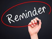 stock photo of memento  - Man Hand writing Reminder with marker on transparent wipe board - JPG