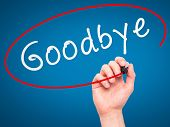 foto of goodbye  - Man Hand writing Goodbye with marker on transparent wipe board - JPG