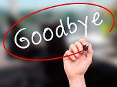 picture of goodbye  - Man Hand writing Goodbye with marker on transparent wipe board - JPG
