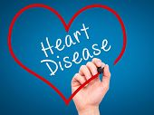 pic of hypertensive  - Man Hand writing Heart Disease with marker on transparent wipe board - JPG