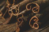 foto of cinnamon sticks  - Close up of cinnamon sticks on wooden background - JPG