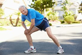 picture of running-late  - Elderly man warming up for run - JPG