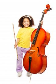 stock photo of cello  - Smiling African girl holding cello with fiddlestick ready to play standing on the white background