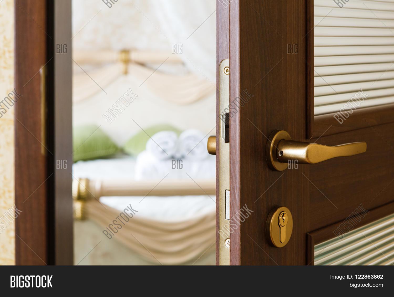 half opened door of a bedroom. hotel bedroom door half open. hotel