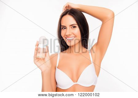 Portrait Of Young Cheerful Woman In White Bra Holding Deodorant