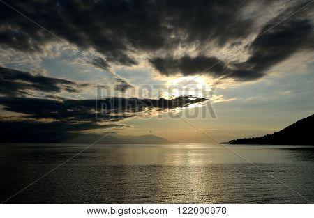 The photo of Ionian sea at sunset in Greece.