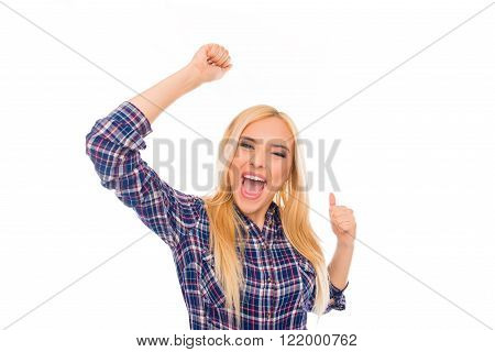Yes! Cheerful happy woman screaming with raised hands