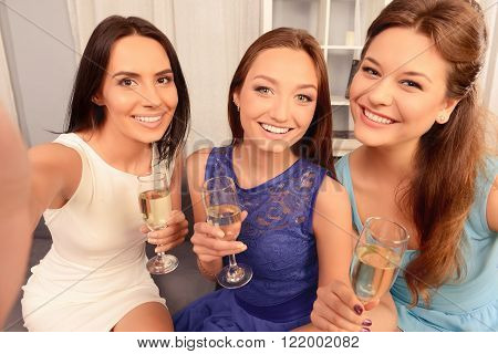 Pretty Girls Holding Glasses With Champagne And Making Selfie