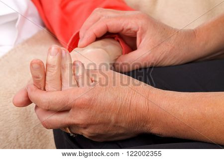 A caregiver checking the patients blood pressure