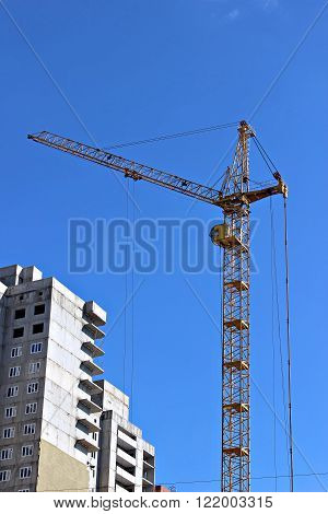Construction of multistory building with a construction crane