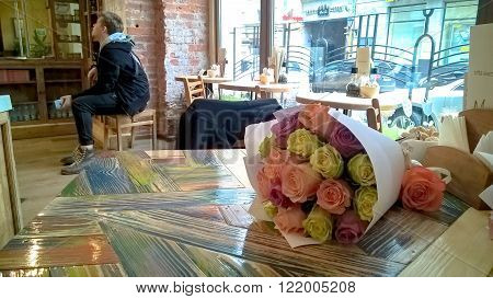 Rose multicolored bouquet on cafe table