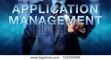 Corporate manager is pressing APPLICATION MANAGEMENT on a touch screen interface. Business concept for data management managed service network support and an approach to outsourced management.