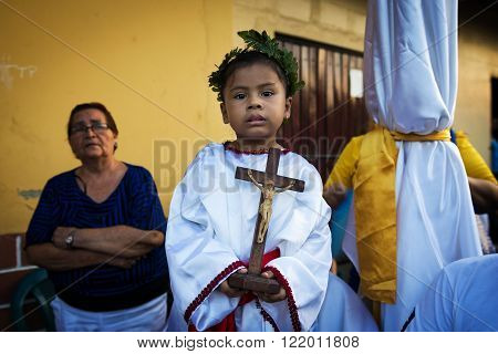 Leon Nicaragua - April 14 2014: People in a procession in the streets of the city of Leon in Nicaragua during the Easter celebrations