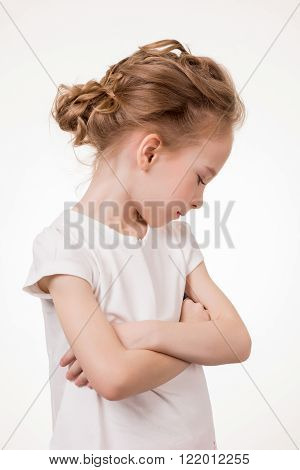 Cute teen girl angry frowns, studio portrait isolated on white background.