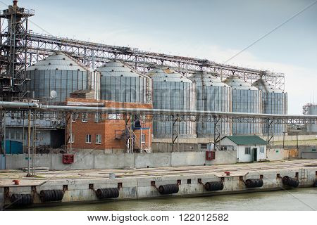 Larger feed industry by the sea where it is processed grains