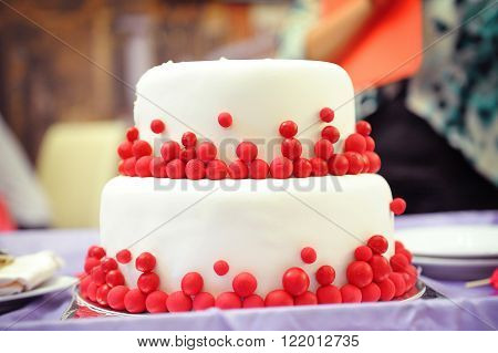 two-tier wedding cake, decorated in the style of Marsala.