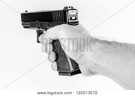 focus on back aim gun sight of black color gun holding in hand isolated on white background