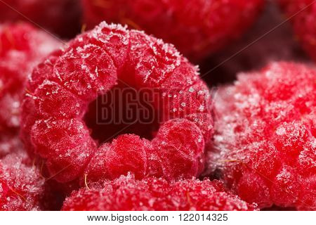 Macro view on frozen Raspberry fruits food background Raspberry