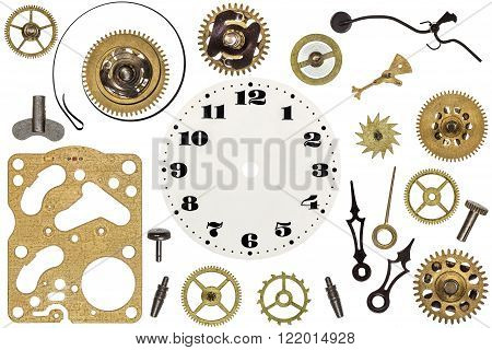 Spare parts for clock. Metal gears cogwheels clock face and other details