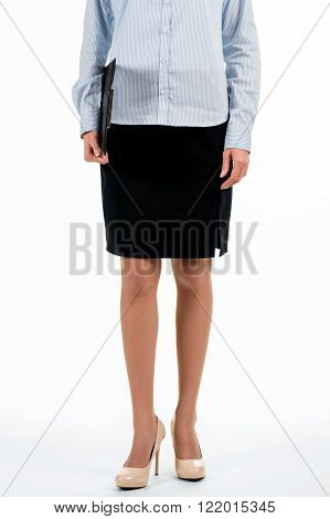 Young businesswoman with clipboard. Female employee holding black clipboard. How to dress for work. Staying serious and looking good.