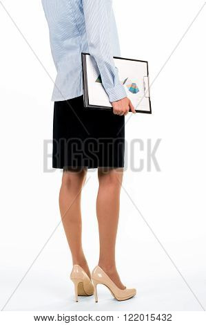 Female carrying clipboard with charts. Woman carrying papers with diagrams. Time to demonstrate monthly report. Market analyst at work.