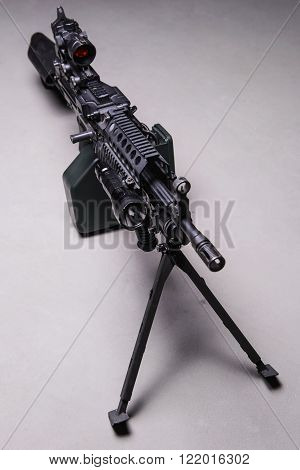 American automatic machine gun with optical sight and LED light